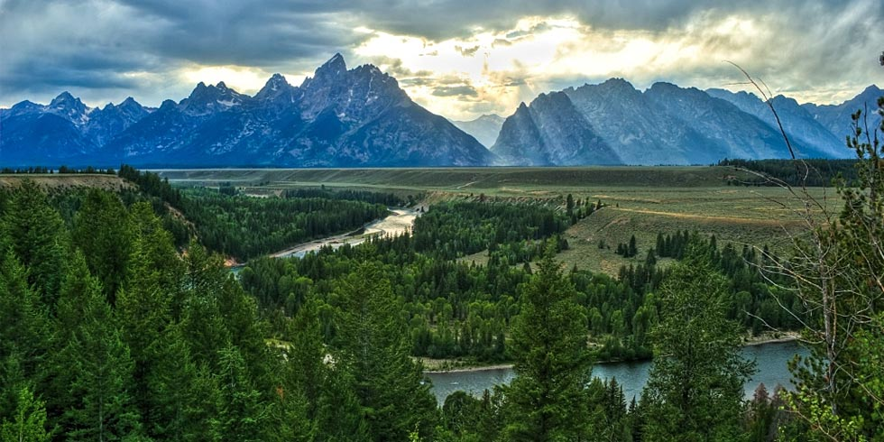The Snake River, in the foreground of the Teton Range, as it rises from the sagebrush covered valley.