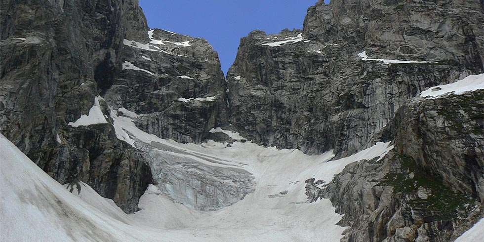 The Teton Glacier clings to the high valley of Glacier Gulch between the Grand Teton and Mount Owen.