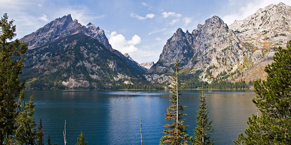 The Cathedral Group towers above Jenny Lake, nestled at the mouth of the glacially carved Cascade Canyon.