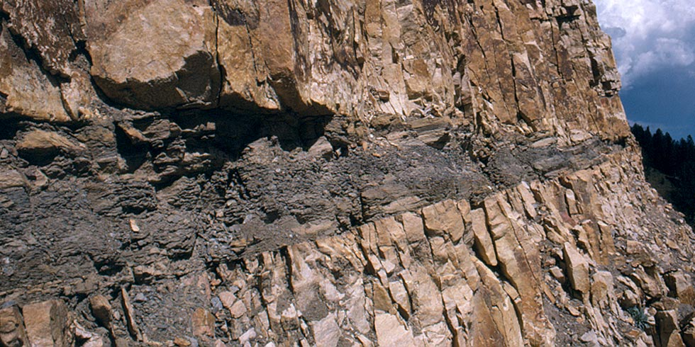 Sandstone sedimentary layers and low grade coal formed in swampy landscapes in the ancient past.