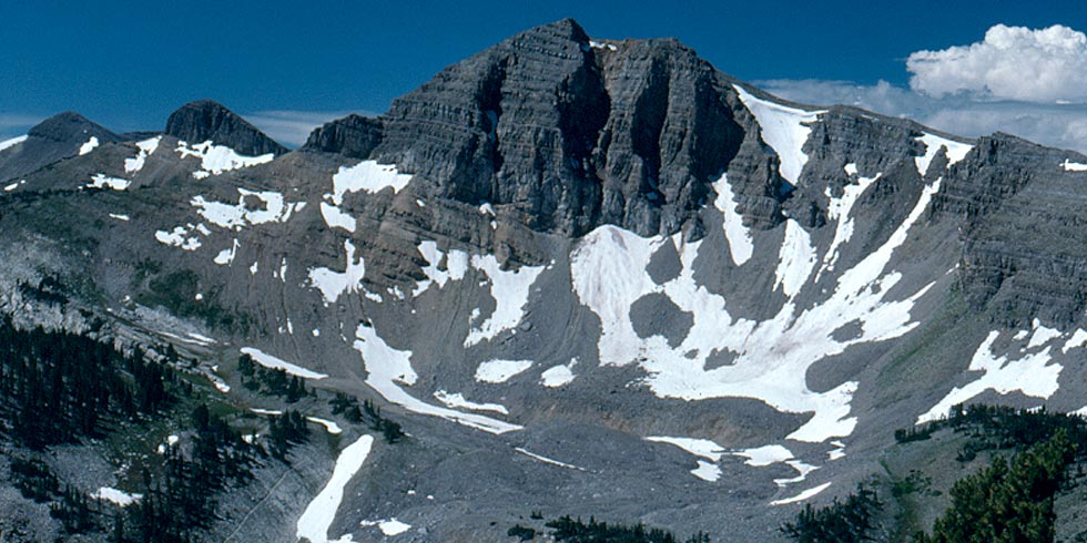 Limestone cliffs west of the taller peaks of the range were formed by ancient seas before the mountains' rise.