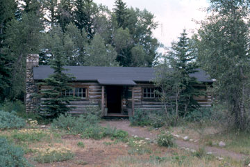 "Meeting at Maud Noble's cabin to discuss preserving the regions ""Old West"" character."